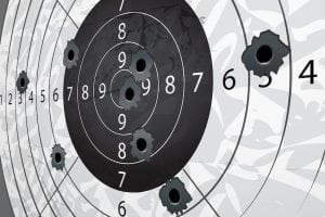 14393006 - gun bullet s holes on paper target in perspective