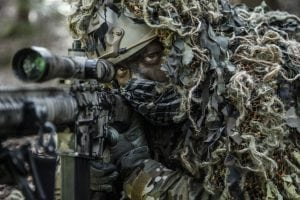 65795607 - united states army ranger sniper wearing ghillie suit