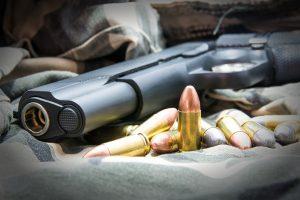 82506446 - gun and golden bullets.